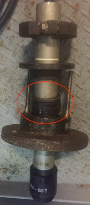 Clean the flange and V-packing